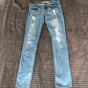 Light colored jeans with rips